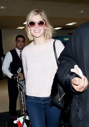 Rosamund Pike opted for a pair of funky oversized star-shaped frames for her travel look.