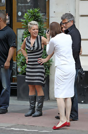 Pink rocked a striped, cowl neck jersey dress.