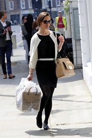 Pippa Middleton matched her classic LBD with a white cardigan and matching white belt.