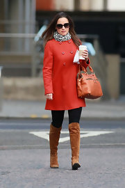 Pippa Middleton kept warm in Chelsea in a chic bright wool coat paired with suede knee-high flat boots.