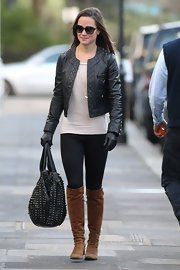Pippa Middleton further toughened her sexy biker style with a studded black leather bag.