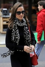 Pippa Middleton added a chic element to her look in a black and white leopard print scarf.