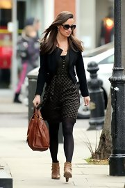 Pippa looked sophisticated yet comfortable in this olive green print day dress.