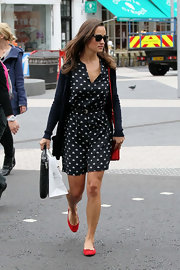 Pippa Middleton added color to her ensemble with red ballet flats.