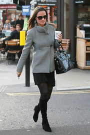 Pippa Middleton bundled up for work in a gray coat paired with black tights and black suede knee-high boots.