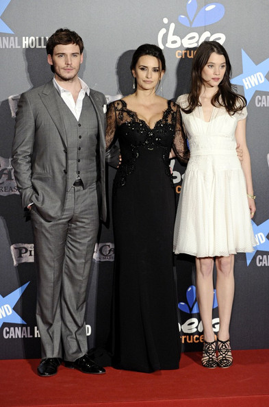 Astrid Berges Frisbey modernized her romantic white dress with black strappy heels.