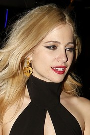 Pixie Lott accessorized with a pair of dangling gold heart earrings while partying in London.