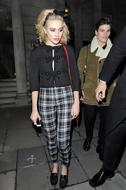 Pixie Lott opted for a mod-inspired look with these black and white plaid pants paired with a fitted jacket.