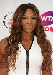 Serena Williams looked quite the diva at the pre-Wimbledon party with her long center-parted curly 'do.