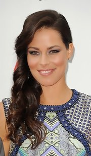 Ana Ivanovic wore her long curls in a lovely side sweep when she attended the pre-Wimbledon party.