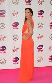 Jelena Jankovic looked divine at the pre-Wimbledon party in a coral evening dress with side cutouts.