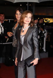 Isabelle Huppert paired a black satin clutch with her gray pantsuit at the premiere of 'Precious.'