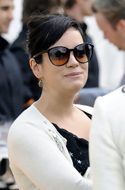 Lily Allen looked classically chic at the Cowdray Park Polo Club in a pair of retro cateye sunglasses with contrasting arms.