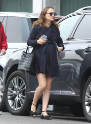 Natalie Portman was spotted out wearing a belted navy swing jacket.