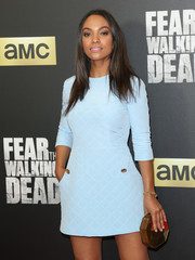 Lyndie Greenwood paired a Rauwolf geometric clutch with a pastel-blue mini dress for the 'Fear the Walking Dead' season 2 premiere.
