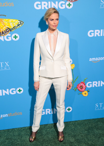 Charlize Theron polished off her look with a pair of gold Dior sandals.
