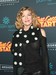Rene Russo styled her black knit top with a polka-dot scarf for the premiere of 'Just Getting Started.'