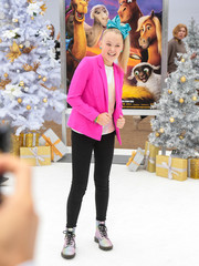 JoJo Siwa pulled her look together with a pair of lace-up boots.