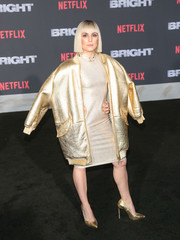 Noomi Rapace completed her metallic ensemble with a pair of gold pumps.