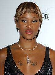 Eve accessorized with a charming leaf pendant necklace at the New Power Awards.