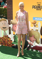 Tori Spelling served up some summer cuteness in a printed pink romper at the premiere of 'The Peanuts Movie.'