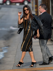 Priyanka Chopra completed her outfit with a pair of black velvet mules by Giuseppe Zanotti.