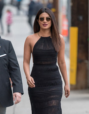 Priyanka Chopra headed to 'Jimmy Kimmel Live' wearing a pair of round sunglasses.