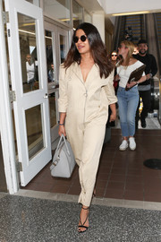 Priyanka Chopra arrived at LAX looking cool in a beige zip-up jumpsuit.