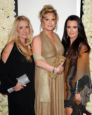 Kathy Hilton topped off her sparkly ensemble at the QVC Style event with a sequined gold clutch.