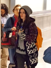 Rachel Bilson kept warm with a gray knit beanie teamed with an oversized cardigan for a flight to LAX.