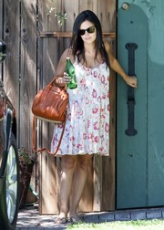 Rachel Bilson added an edgy-glam touch with a rust-colored Alexander Wang stud-bottom tote.