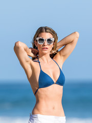 Rachel Mccord enjoyed a day at the beach wearing a pair of thick-rimmed print sunglasses.
