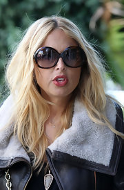 "Rachel Zoe walked down Robertson Blvd. in a pair of her trademark oversize ""sunnies."""