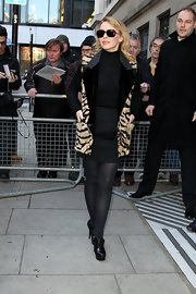 Kylie Minogue was chic in black, wearing an animal-print jacket paired with black leather ankle boots.