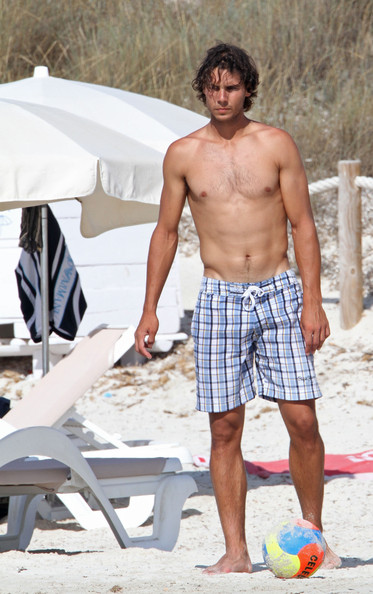 Tennis great Rafeal Nadal wore plaid swim trunks while vacationing on the beach.