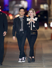 Lucy Boynton teamed her top with black skinny jeans.