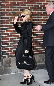 "Madonna showed up at ""The Late Show with Dvid Letterman"" in New York donning a coveted Dolce and Gabbana tote bag from the Spring 2010 collection."