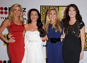 Adrienne Maloof accentuated her tiny waist with an oversized black belt.