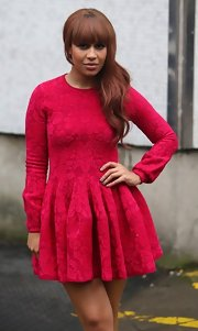 Rebecca Ferguson looked conservative up top and flirty down below in this crimson cocktail dress when she arrived at the London Studios.
