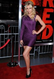 Alyson paired her patent leather pumps with a vibrant purple dress while hitting the premiere of 'Red'.