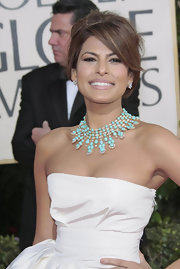 This turquoise necklace is the highlight of this gown. It looks ravishing on her skin tone.