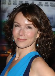 Jennifer Grey wore tight curls with side-swept bangs for a sweet look during the 'Redbelt' premiere.