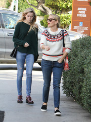 Ava Phillippe teamed her sweater with ripped skinny jeans.