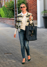 Reese Witherspoon finished off her ensemble with an oversized suede tote by Draper James.