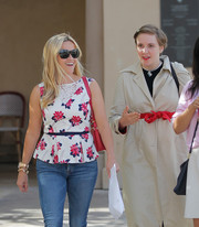 Reese Witherspoon stepped out on a sunny day wearing modern rectangular shades.