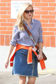 Reese Witherspoon accessorized with a pair of butterfly sunglasses while out on a stroll.