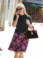 Reese Witherspoon showed off a vintage-chic burgundy velvet tote by Miu Miu while out and about in LA.