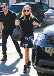 Black leather booties rounded out Reese Witherspoon's ensemble.