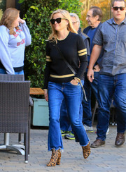 Reese Witherspoon pulled her outfit together with a pair of leopard-print ankle boots by Raye.
