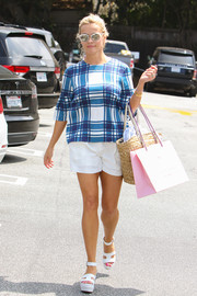 Reese Witherspoon went shopping looking sprightly in a plaid blouse and white shorts.